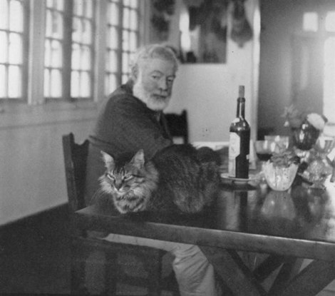 Ernest Hemingway with one of his many cats
